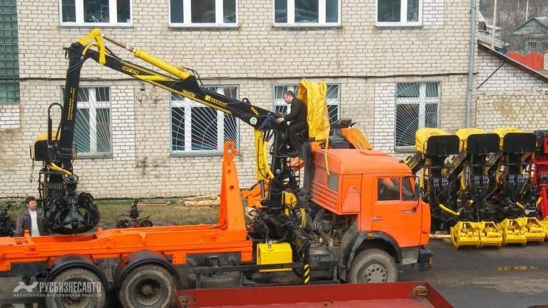 Фото №3:Ломовоз КАМАЗ 65115-3094-23 с ОМТЛ-97 и мультилифтом